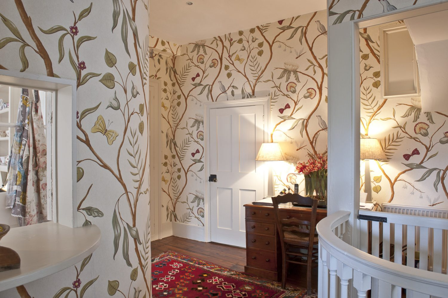 Adam's Eden by Lewis and Wood, Belinda's favourite wallpaper, looks very much at home in the hallway