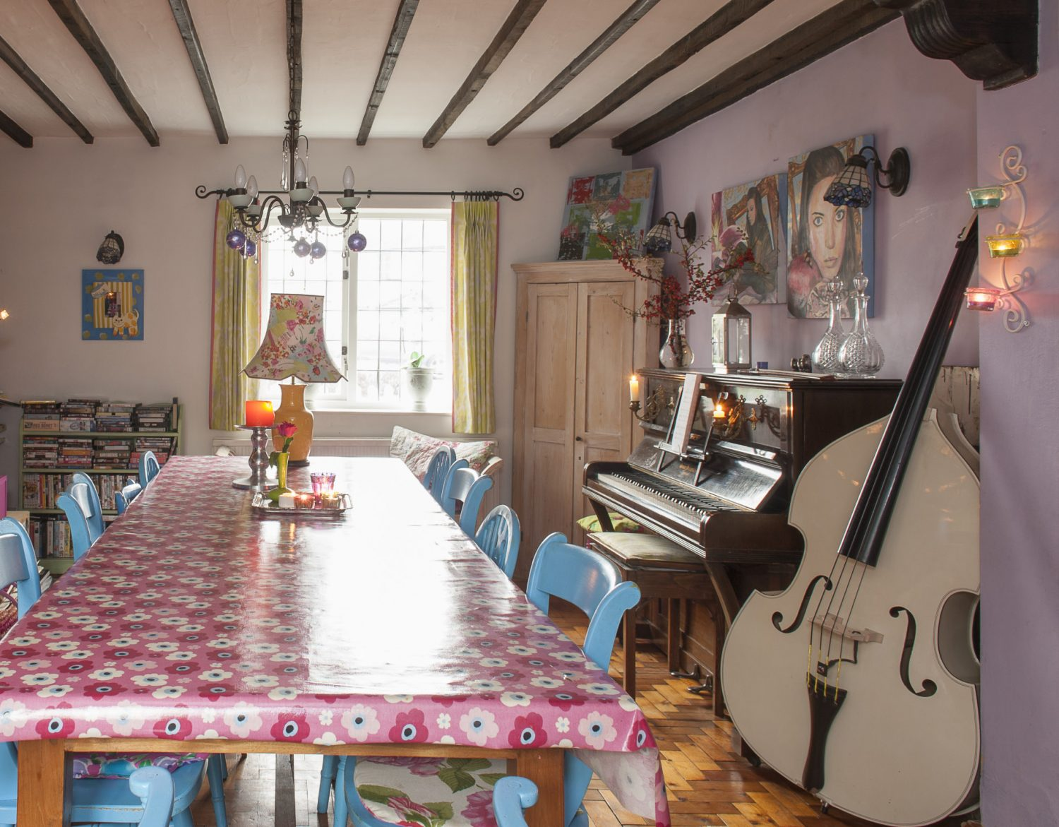 The spacious dining room is painted a strong lilac and everywhere there are witnesses to the family's artistic and musical commitments