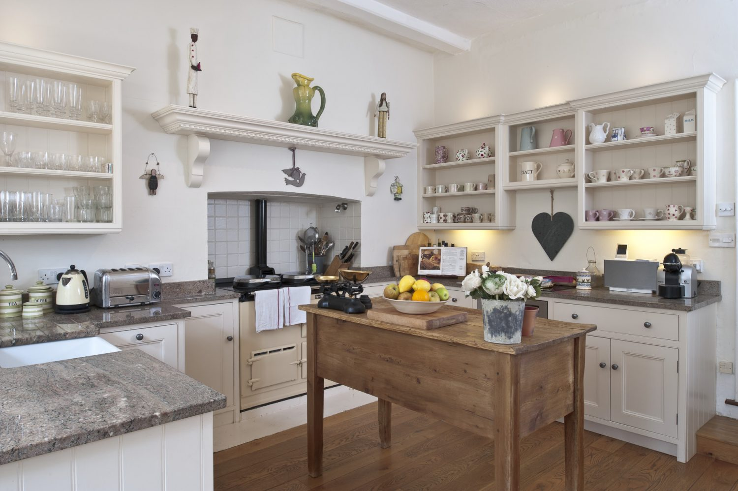 Belinda particularly likes the open shelves in the kitchen as they are a way of adding colour with crockery and reflecting light off the glass