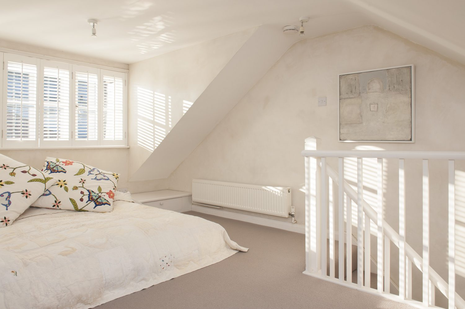 On the top floor, the master bedroom is a bright and airy sanctuary, completely free of clutter