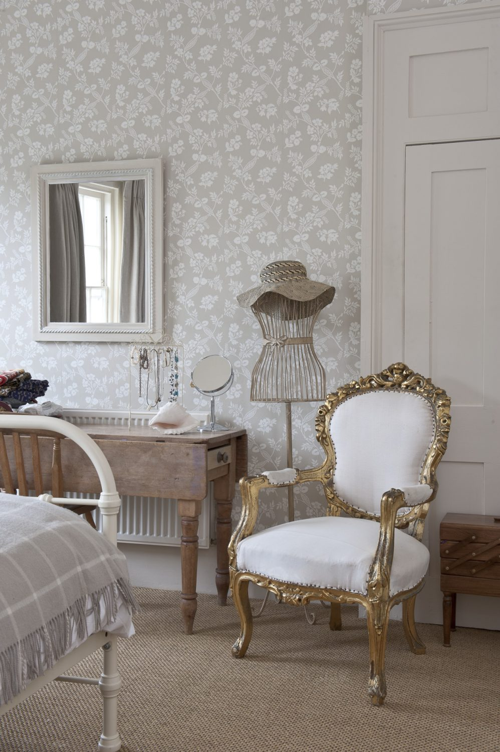 Colefax and Fowler wallpaper takes centre stage in one of Belinda's daughters' rooms