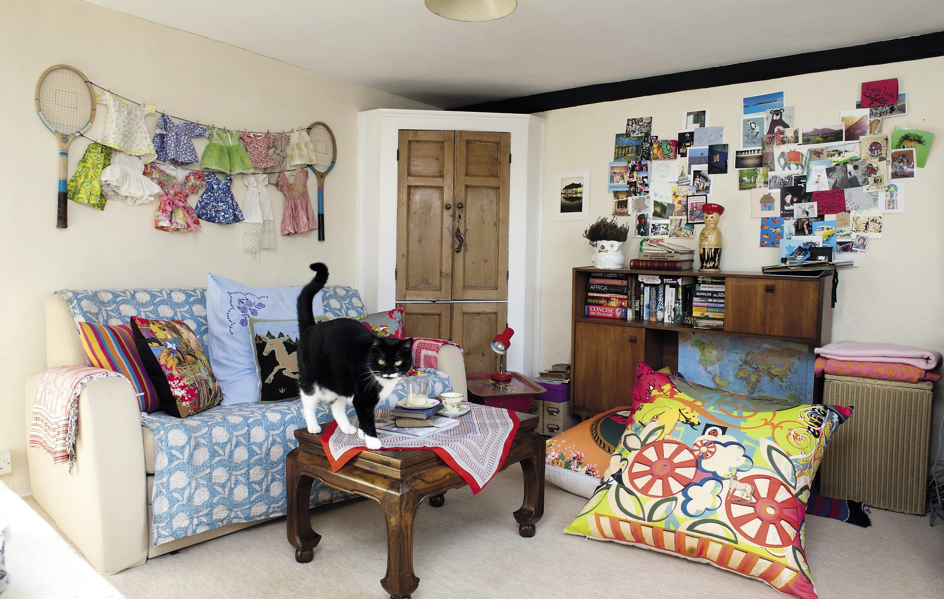 The snug on the first floor is home to some of the fabrics that Laura can't resist accumulating