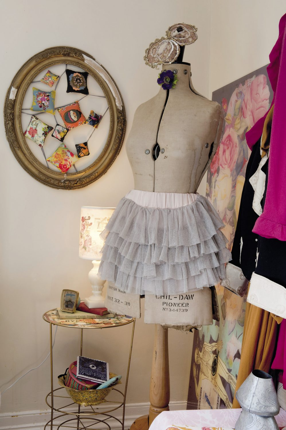 A tailor's mannequin wears a frilly skirt