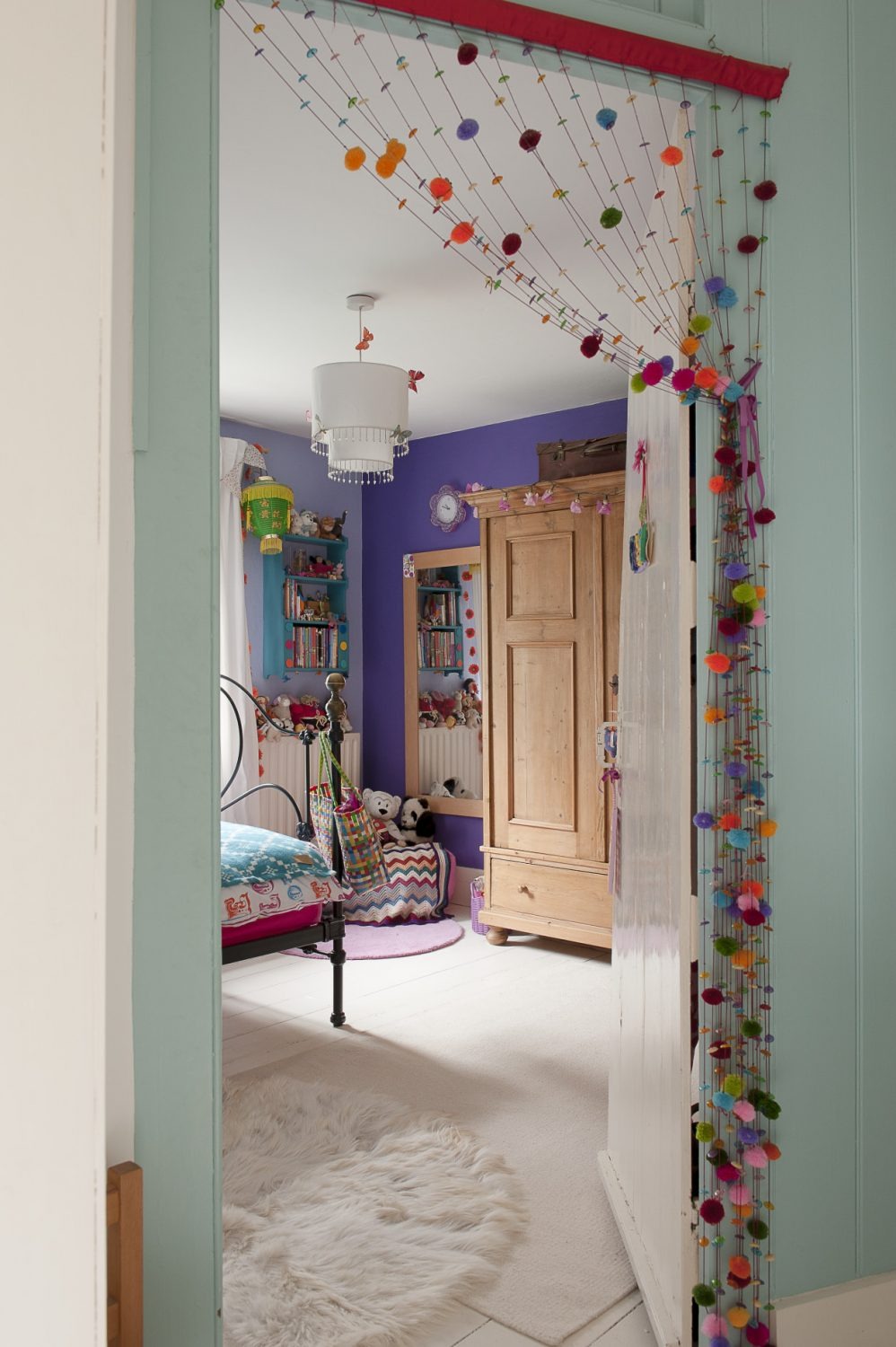Daughter Gabrielle's room is just as colourful as her sibling Dominic's and features a bold floral mural on one wall