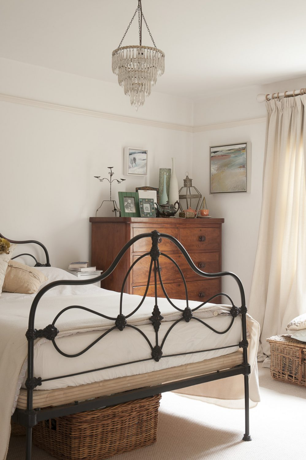 Upstairs the star of the show in the crisp, white master bedroom is a lovely period art nouveau wrought-iron bed