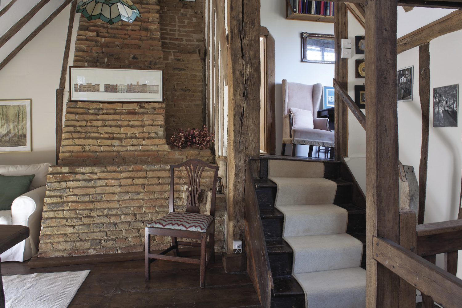 A small flight of stairs leads to the master bedroom and floor above