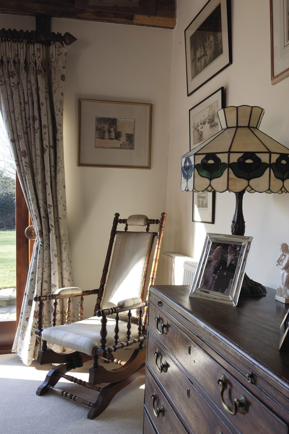 """The cosy drawing room is the heart of the home where the whole family gather together to sit in front of the fire with a bottle of wine. """"We're fortunate because the children come back here often and I think the house has quite a lot to do with that,"""" says Daphne"""
