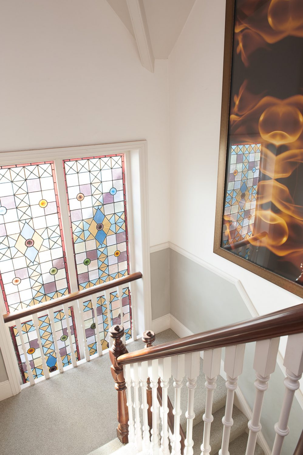As we climb the stairs we come across a huge photograph of flames, manipulated using Photoshop into a giant fire design. The first room we enter is called Hafez. The room has a tranquil, airy feel and despite the fairly dark coloured walls is flooded by light from the huge bay window...