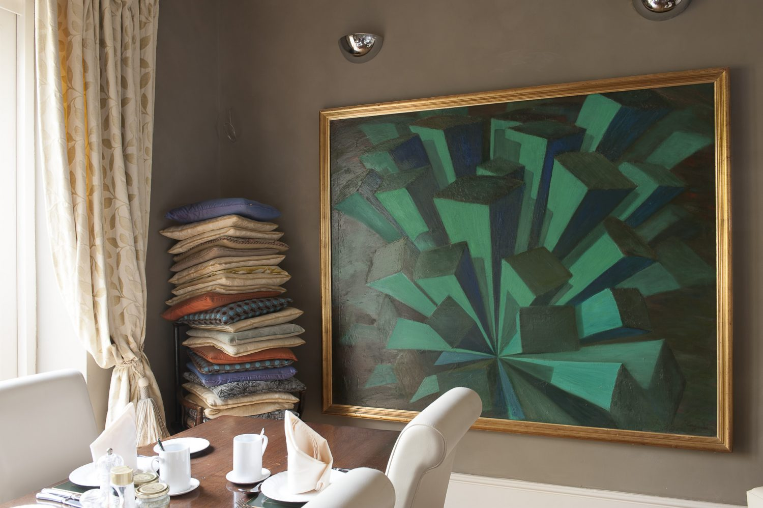 A painting Shahriar created whilst studying for his degree takes centre stage on one wall of the dining room