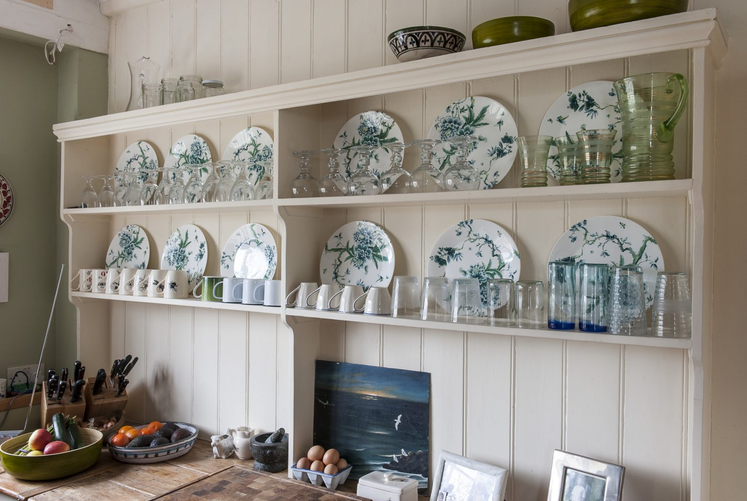"""A big, built-in dresser extends along one wall, its shelves displaying a stunning set of much-loved, green Jasper Conran Wedgwood. """"I really designed the kitchen around the Wedgwood,"""" says Francesca"""