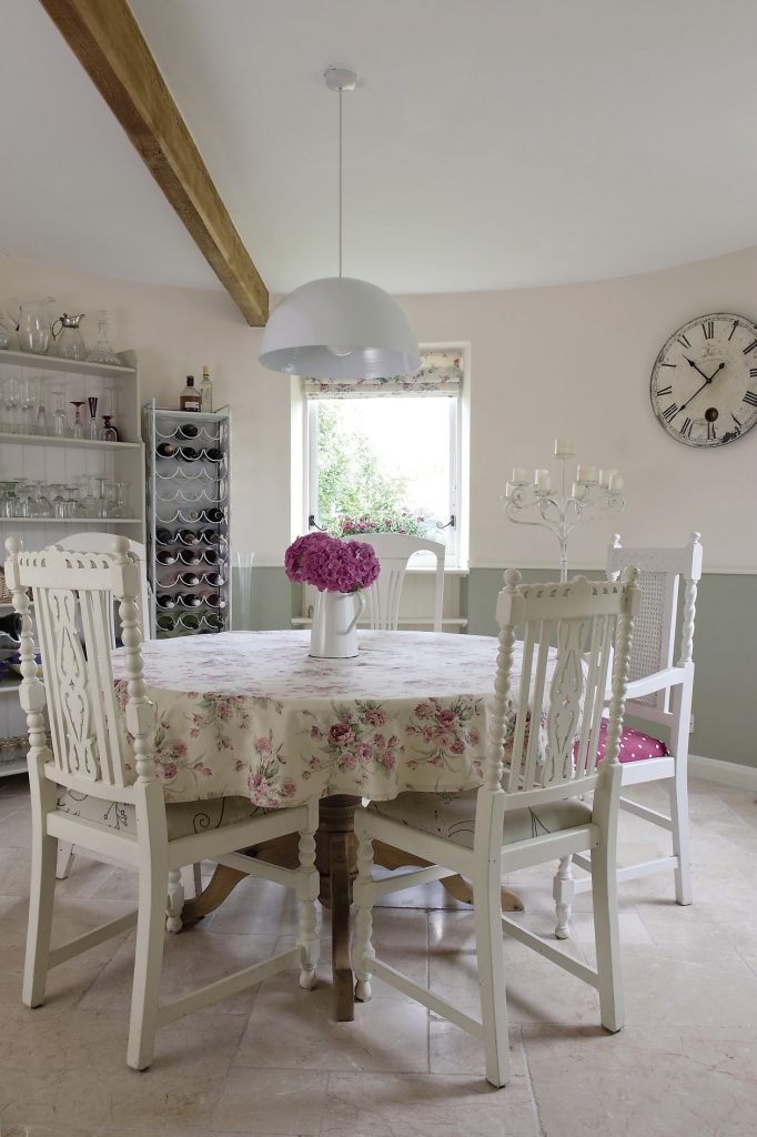 Originally the dining room roundel was accessed solely from the hallway but Katy has provided additional access from the kitchen. Here Katy has accentuated the space and height of the roundel by keeping furnishing to a minimum – just a wine rack and shelves to display her eclectic collection of glasses