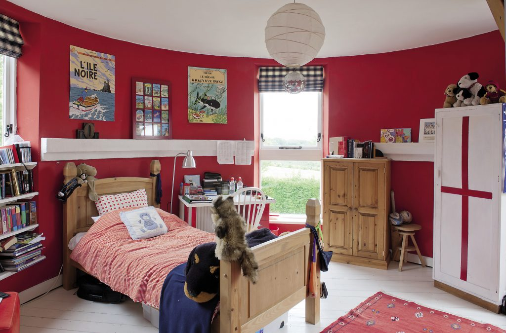 Son Tom's room is deep red, very much a boy's room and currently shrine to Tin Tin, a legacy of the family's time in Brussels
