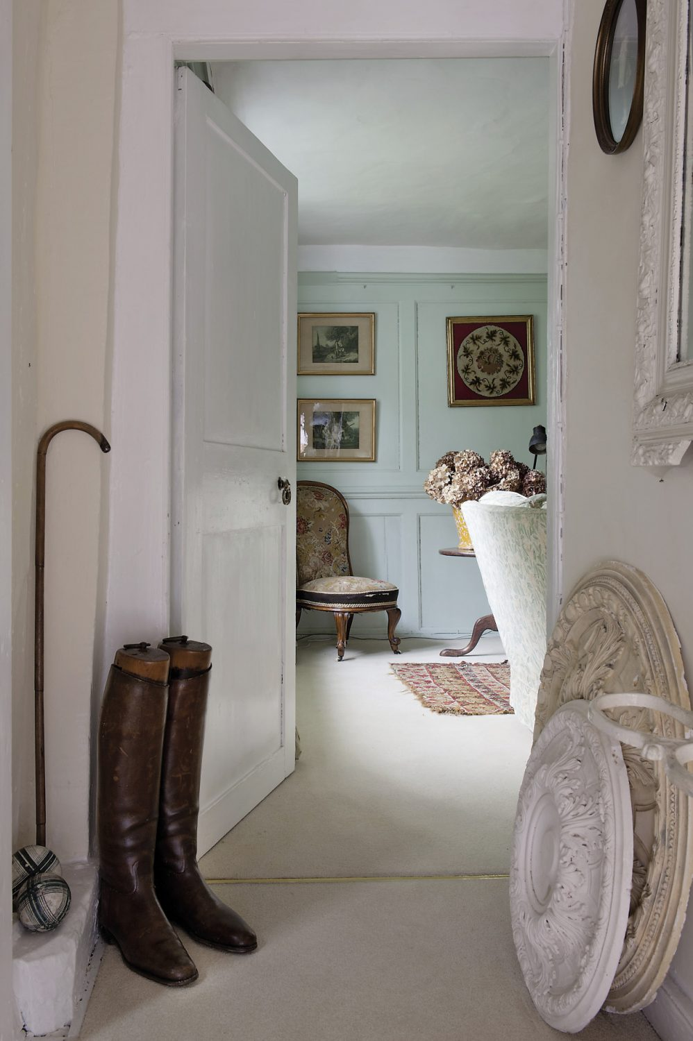 A corridor leading off from one corner of the sitting room leads to a more formal drawing room, its panelled walls decorated in a soft eau de nil
