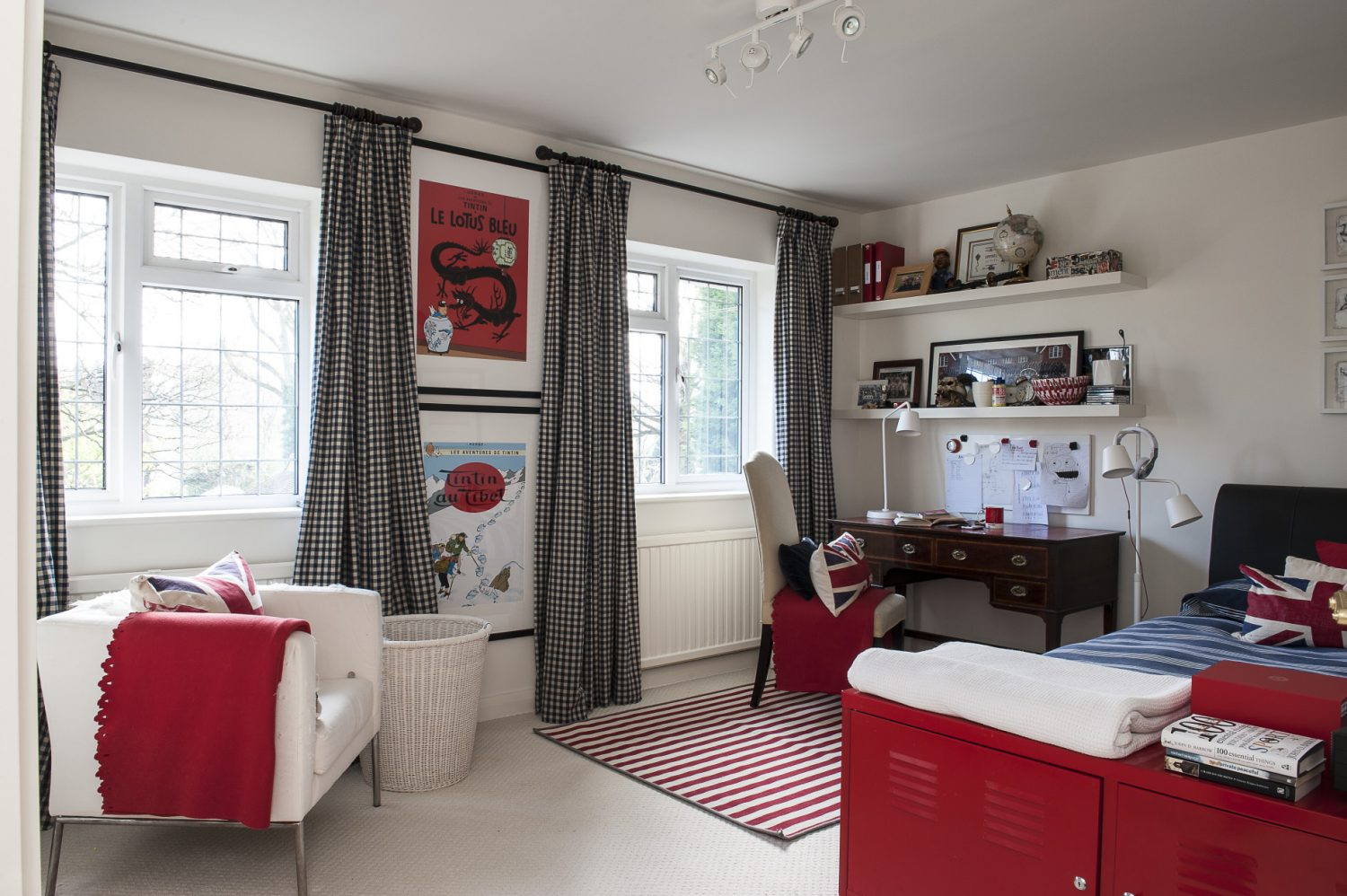 Adele's son's room is red and white and a pleasing juxtaposition of old and new