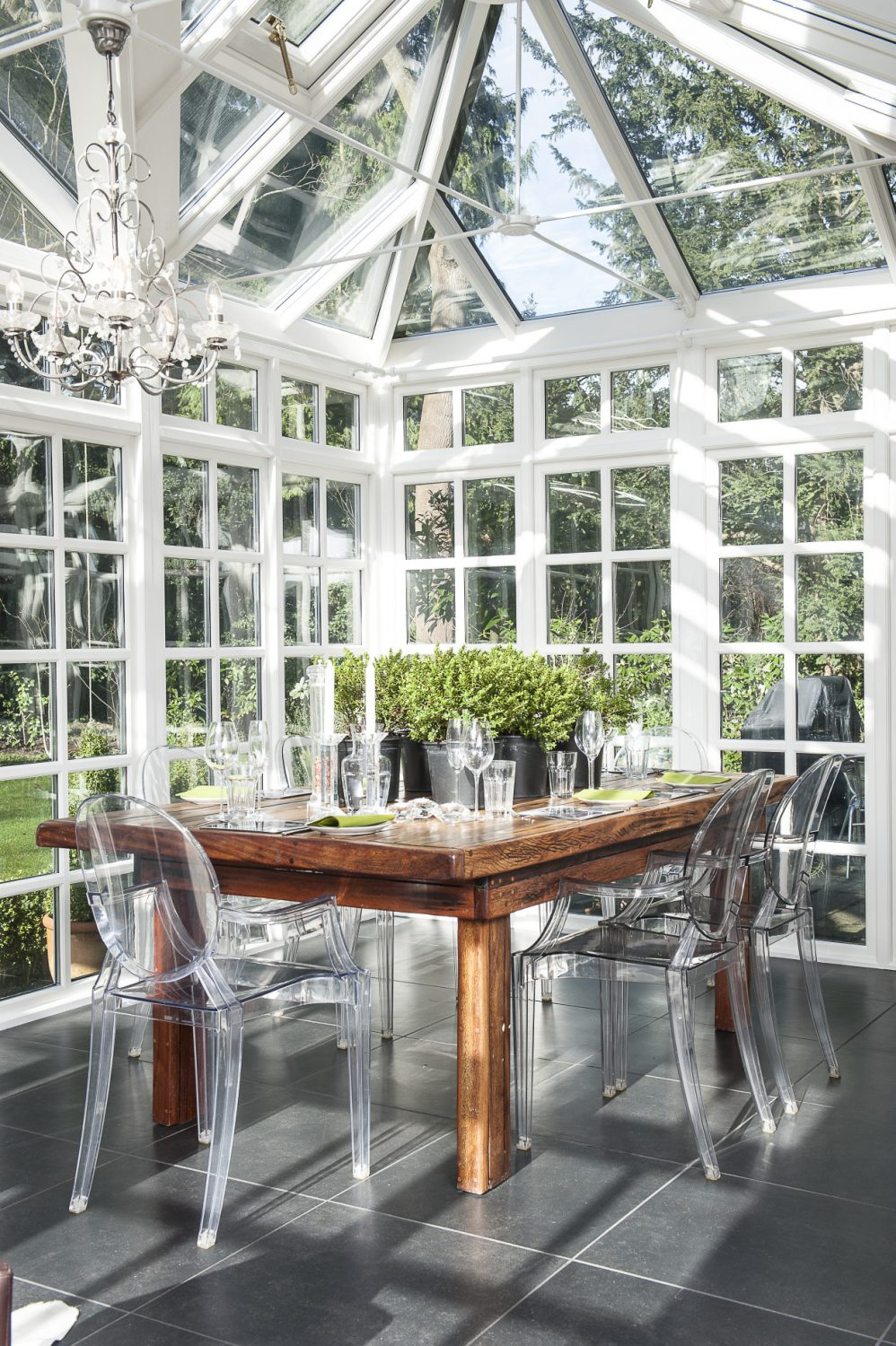 Philippe Starck chairs surround a wonderful dining table, made from old African railway sleepers, which once graced the couple's veranda in South Africa