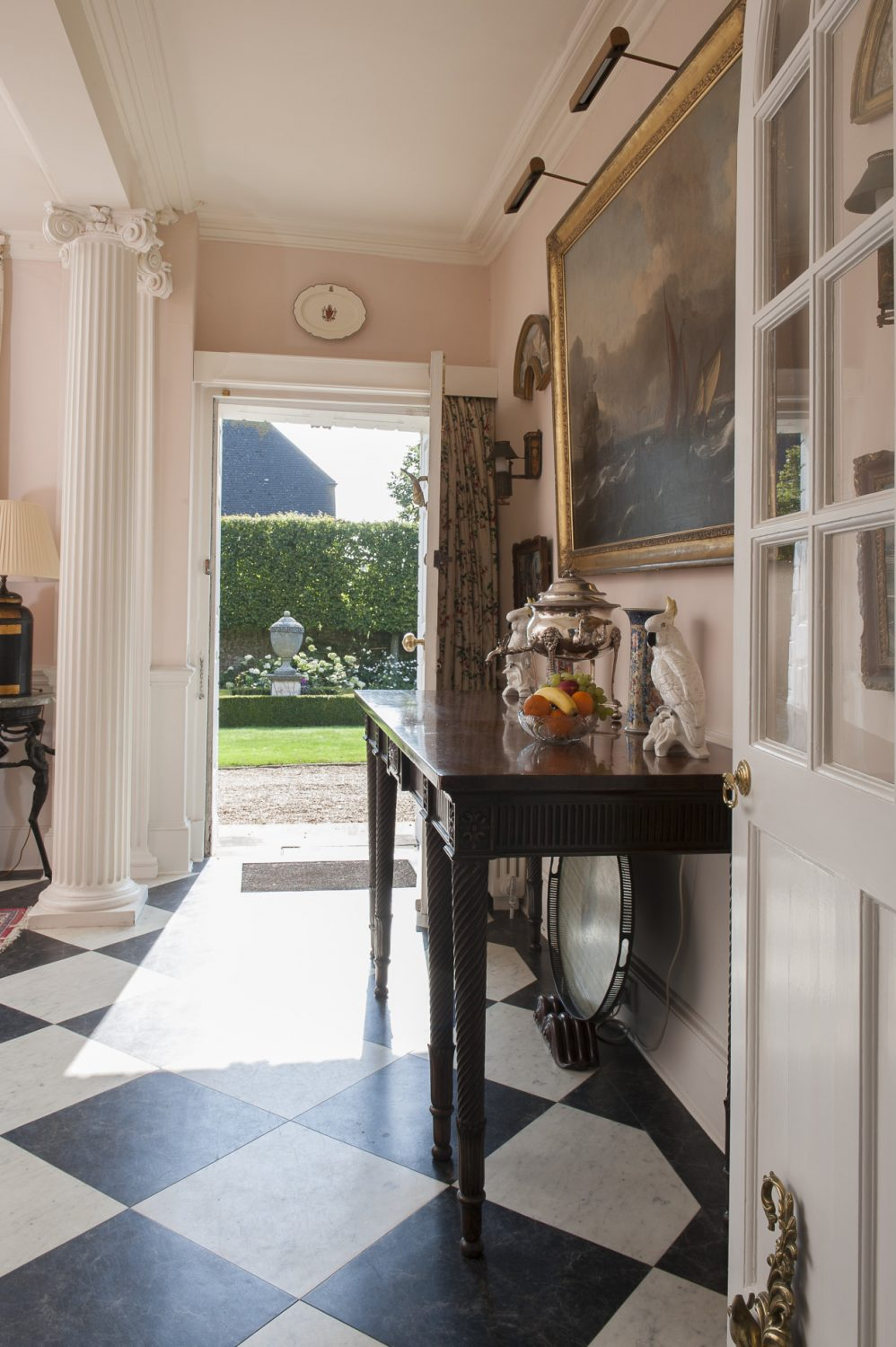 I used Amtico black and white floor tiles on the diagonal to keep the sense of an entrance hall but the colour of the walls is a welcoming one