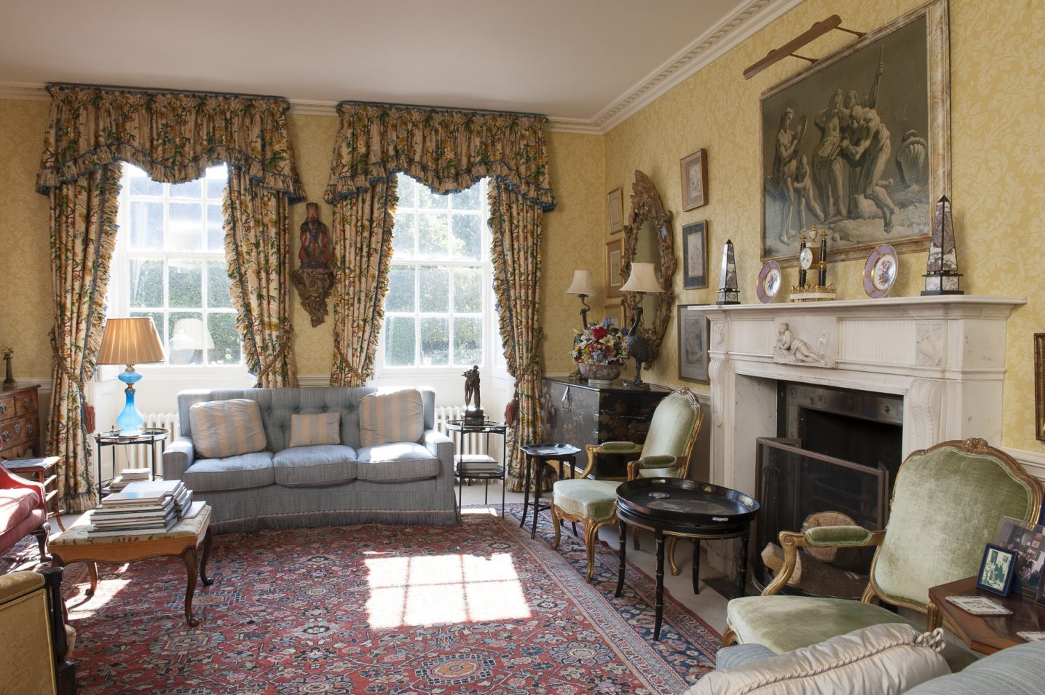 The drawing room was originally two rooms, that were made into one in the 1830s. The walls are papered in Zoffany 'Damask Design'