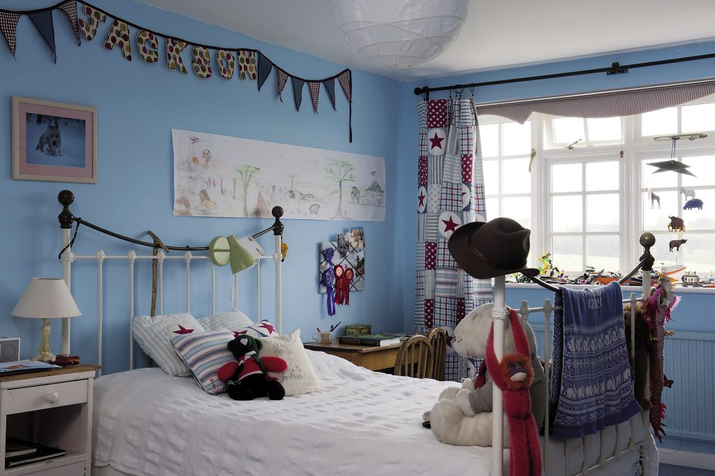 Son Jackson's room looks like the lair of a budding explorer with its bold sky blue paint and pictures of exotic animals and placesSon Jackson's room looks like the lair of a budding explorer with its bold sky blue paint and pictures of exotic animals and places