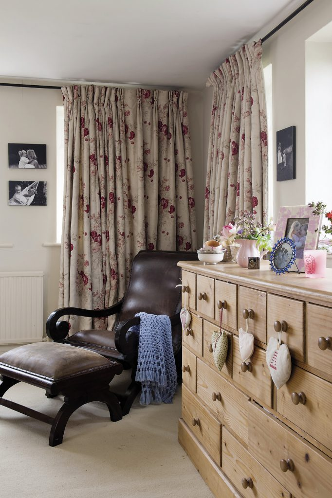 The master bedroom and en suite. A long chest of drawers from Country Pine stands in front of one window with jugs of garden flowers and sweetly scented herbs to perfume the air
