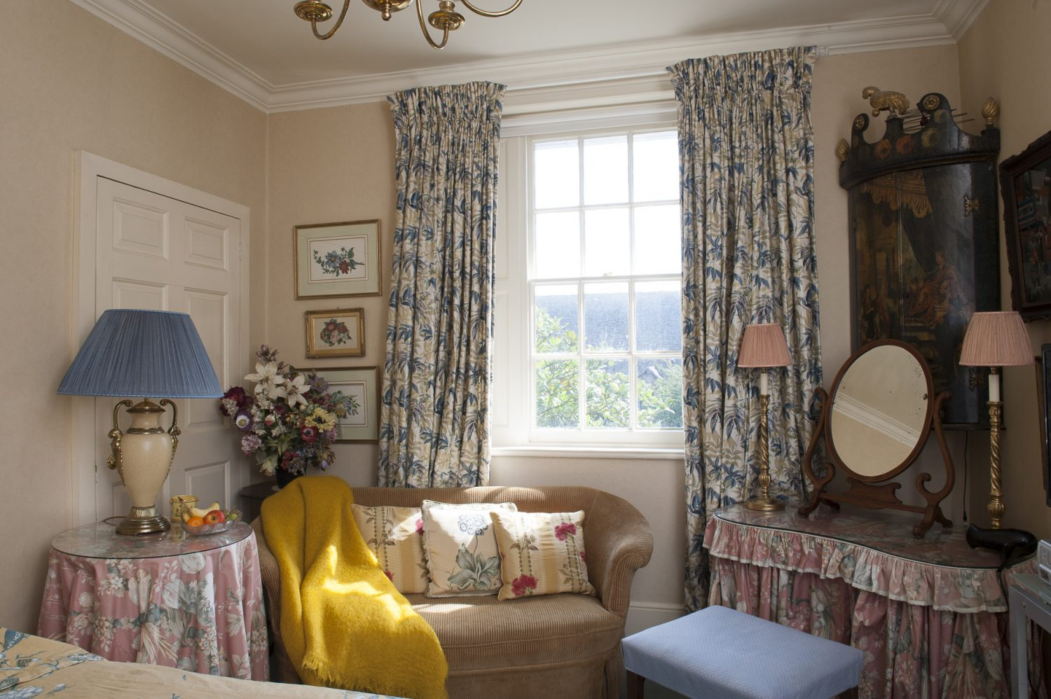 The second guest room known as the East Room is decorated in a soothing combination of teal blue and soft ochre