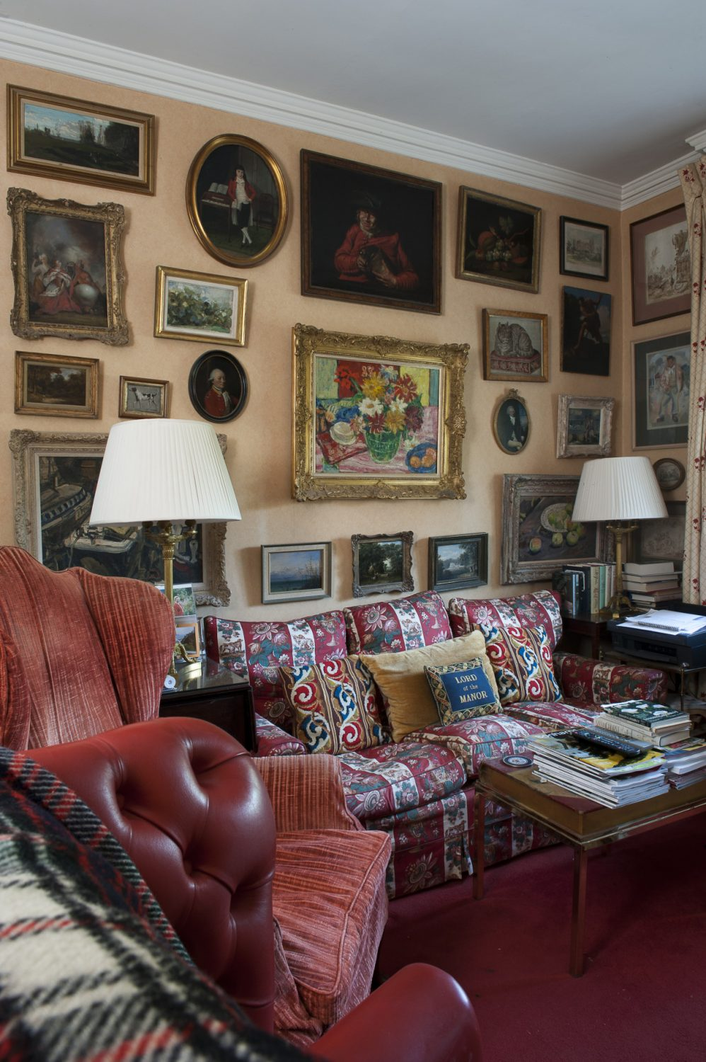The walls of the snug are a tightly packed collection of colourful paintings and drawings