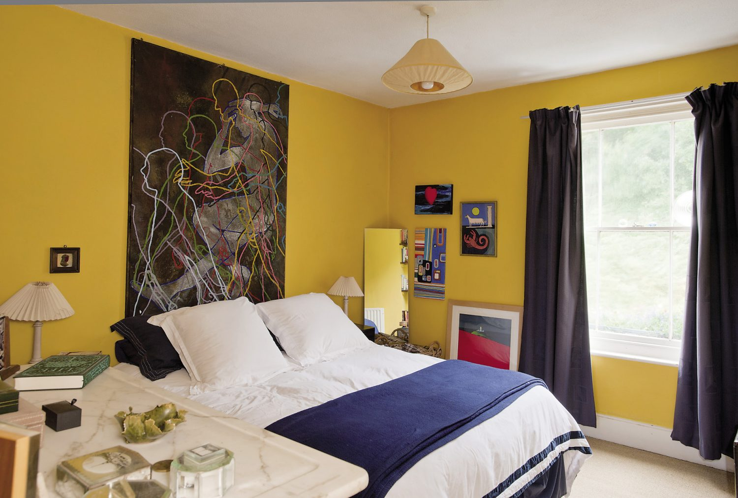 The master bedroom. Above the bed is a painting by the Grey Organisation, an artists' collective that was active in London in the 80s
