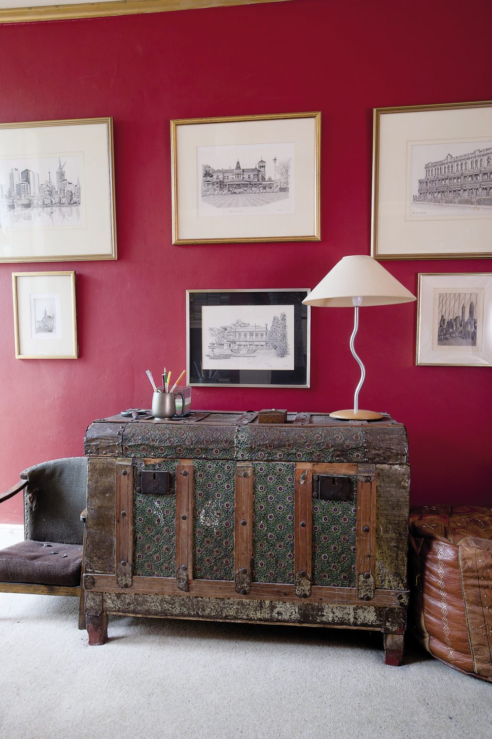 Alastair's love of travel is evident throughout the sitting room, from the oriental rug on the floor to the kilim-style printed fabric that covers the armchair