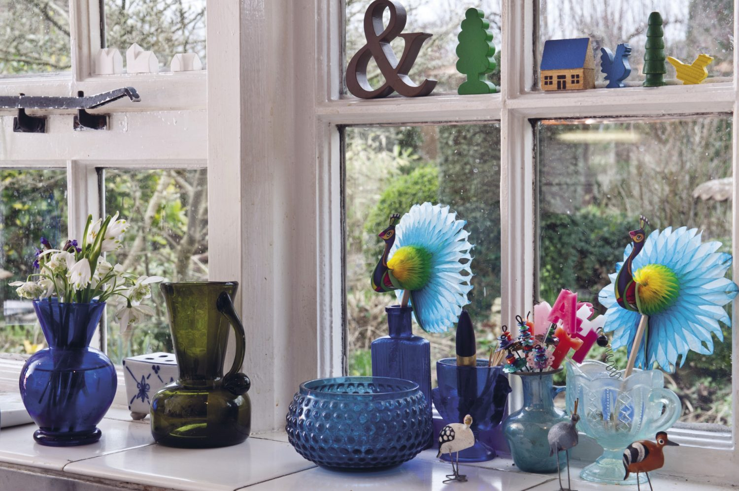A windowsill full of interesting and beautiful finds