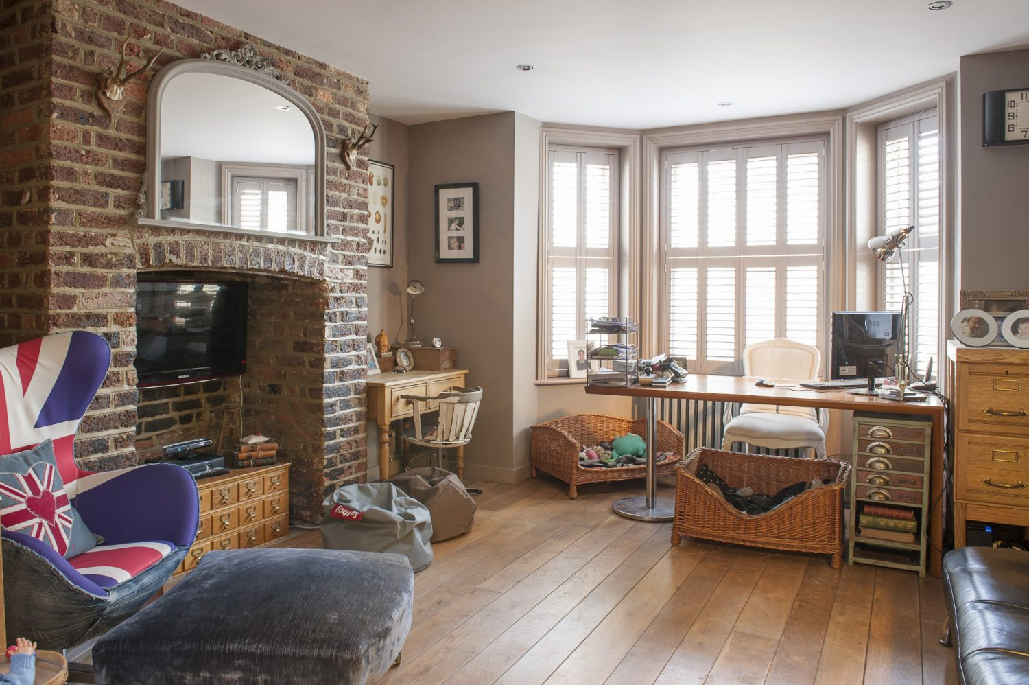 The walls are the original glowing brick and white lime mortar and the floor throughout oak boarding
