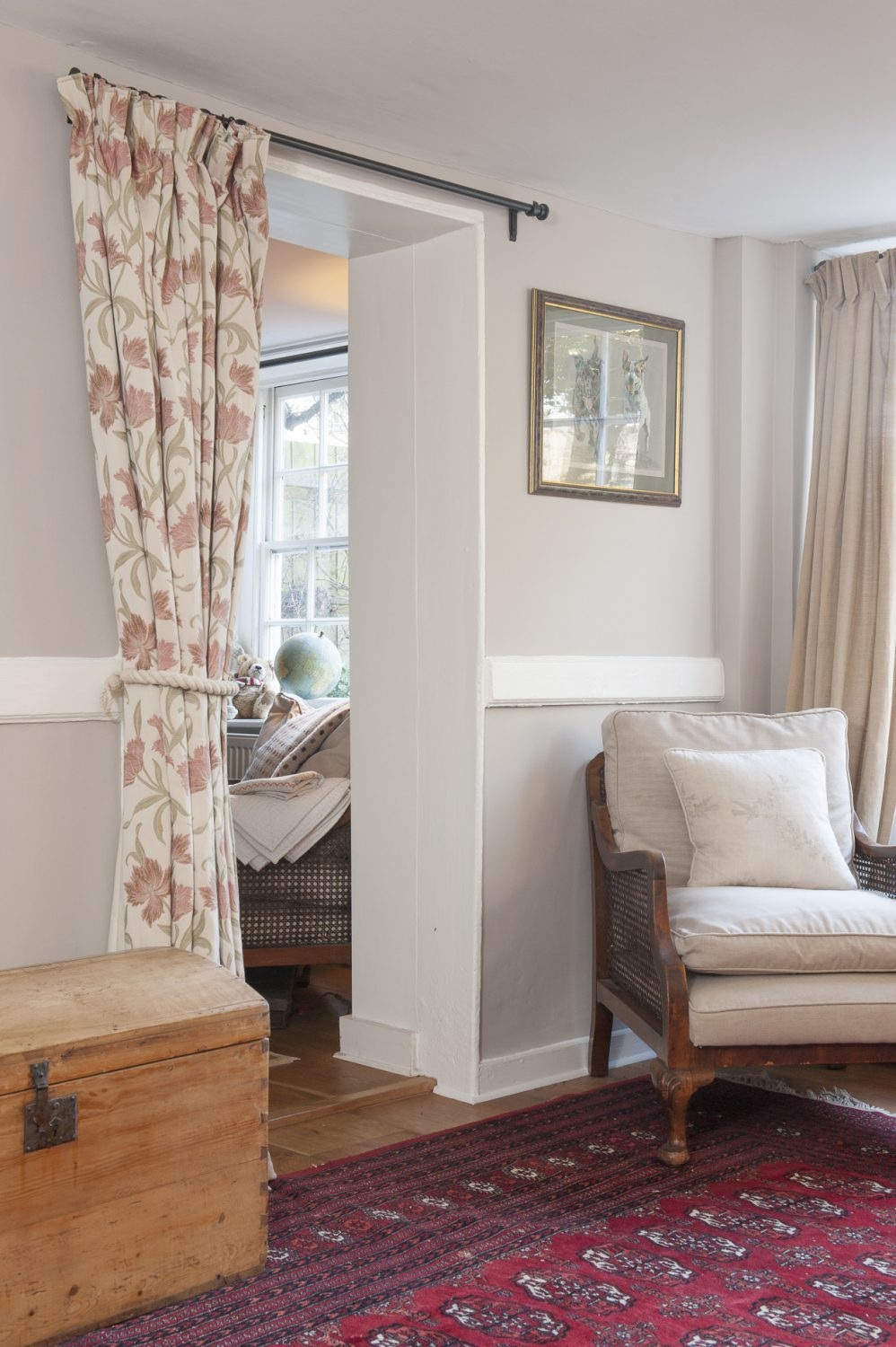 One enters the original cottage into a hallway which might have been one of the original reception rooms