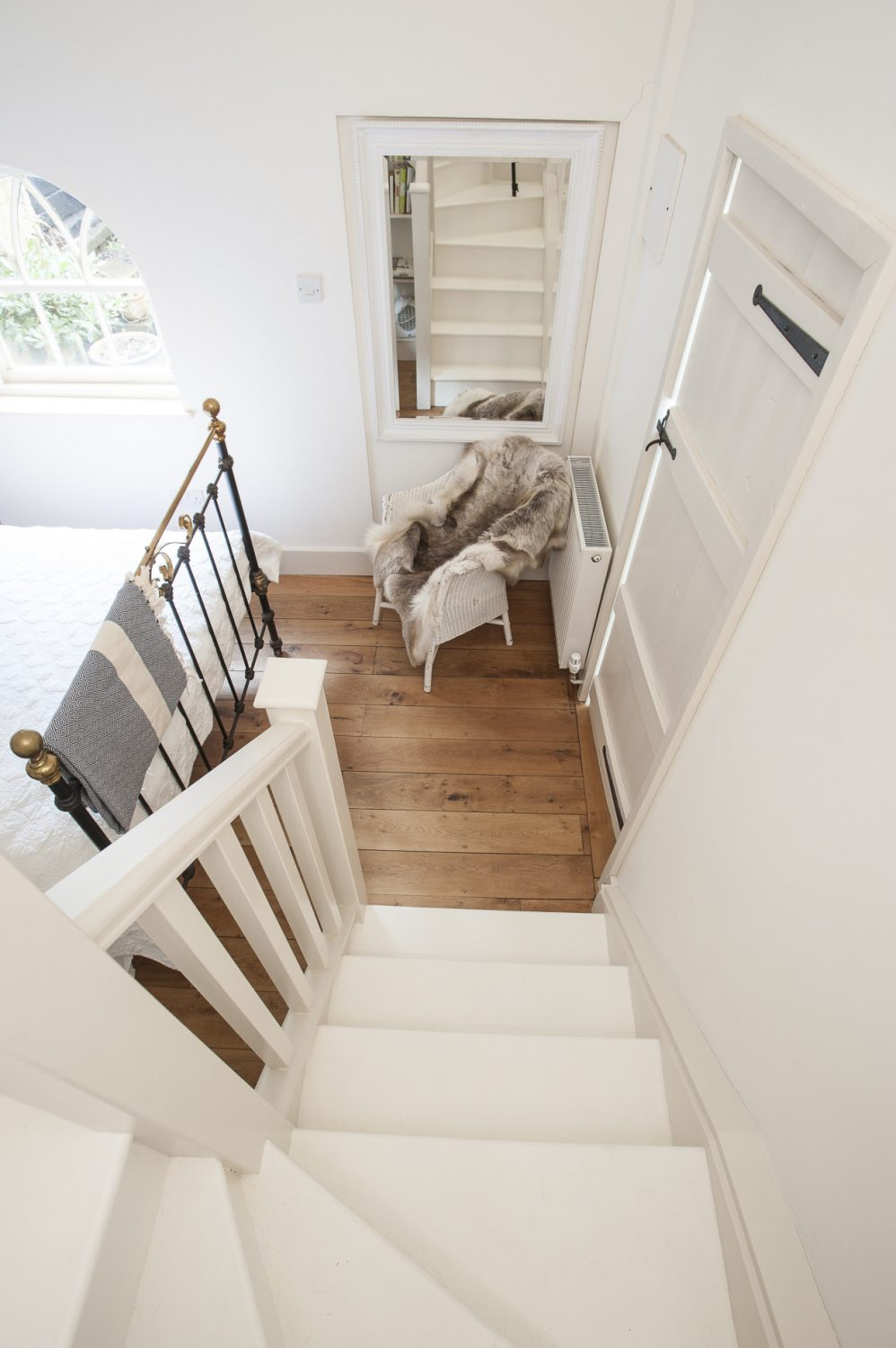 Up the stairs, off a little white galleried landing, is a wonderful en suite bathroom with roll-top bath