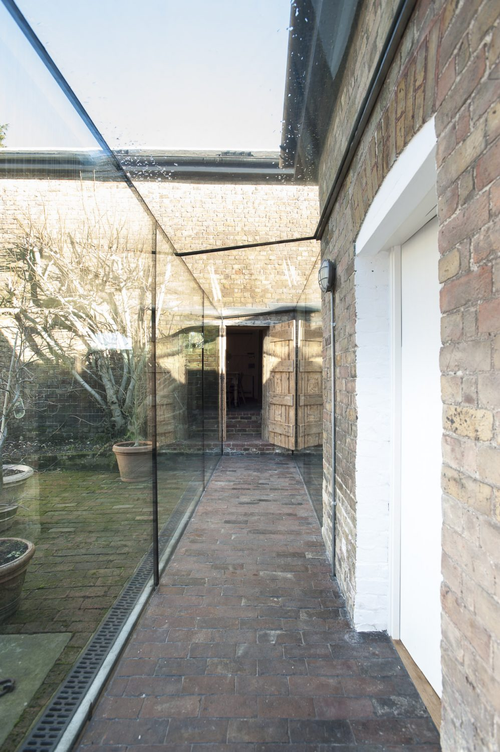 """Adrian undertook the mammoth task of installing the glasswork himself, enlisting the help of a spider crane into the courtyard. """"It was pretty nerve-wracking but it worked,"""" he says"""