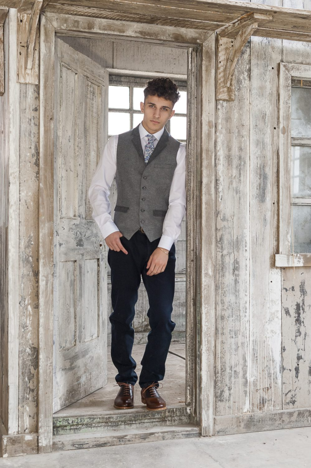 Claudio Lugli grey waist coat & jacket, £275, Profuomo brown leather belt, £60, MMX jeans, £129, Liberty print tie, £29.50, Olymp white shirt, £59.50, Barker Harry shoes, £250, County Clothes, Canterbury 01227 765294 / Tenterden 01580 765159 / Reigate 01737 249224 countyclothesmenswear.co.uk