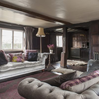 In the formal drawing room beautiful dark oak panelling, originally from a monastery and dating from the mid-1700s, covers the walls