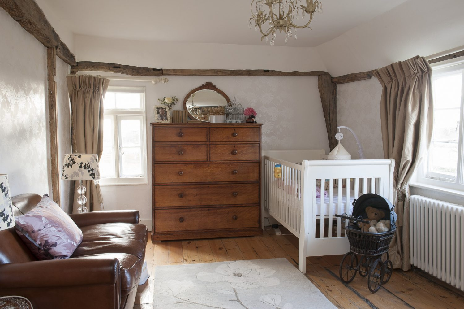 The guest bedroom along with daughters Grace and Ella's rooms all feature curtains made by Charlotte from Laura Ashley fabric