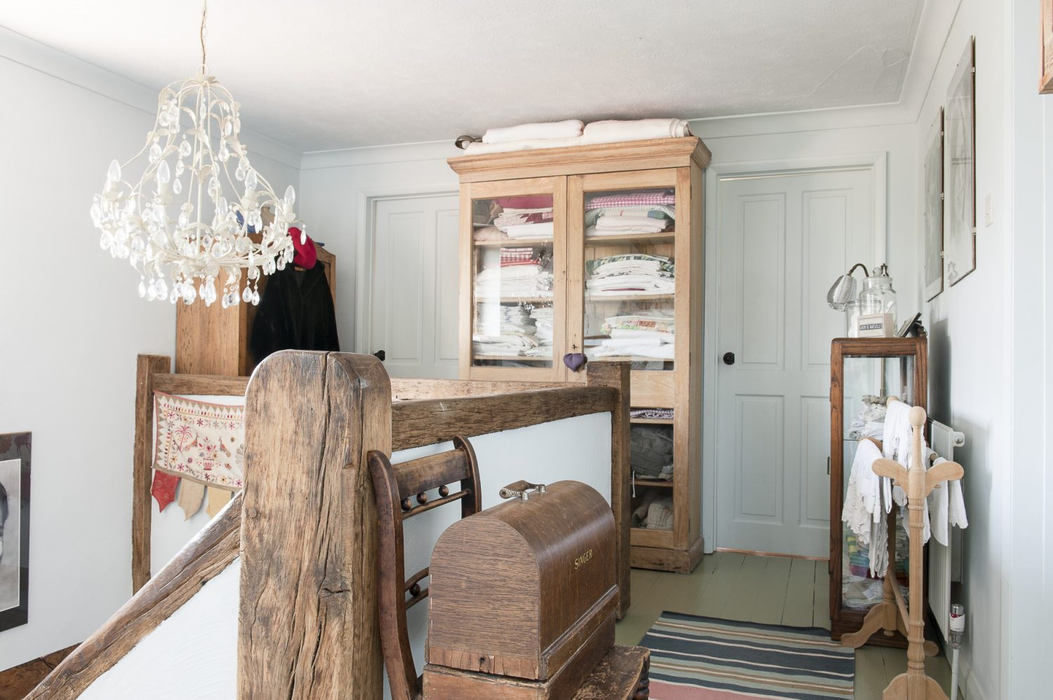 Upstairs, past black and white family photos – just a few of many of the generations past and present on walls upstairs and down – is yet another example of the effective display of possessions that most of us might keep shut away...