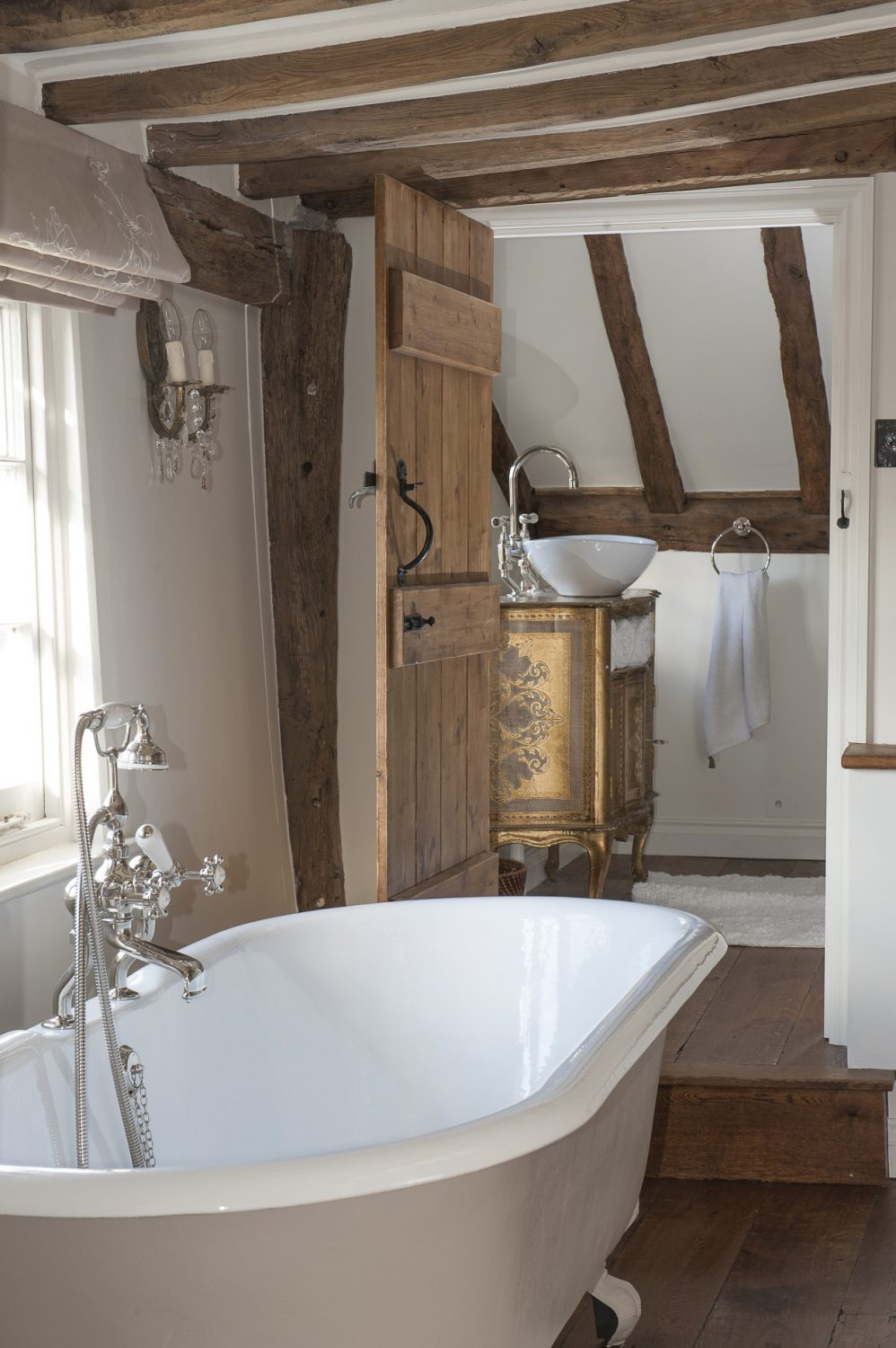 Charlotte and Andrew remodelled their en suite to provide both a romantic bathroom, with a rolltop bath, and a double-shower room