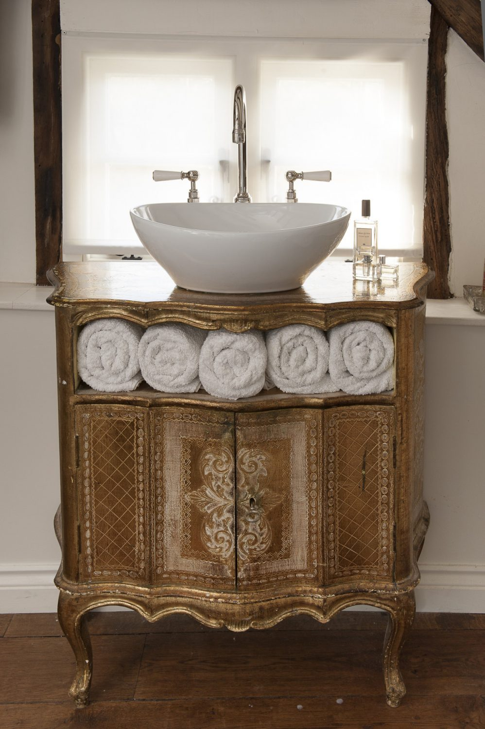 The elegant basin on a former Italian telephone table from La Belle Étoffe in Frome