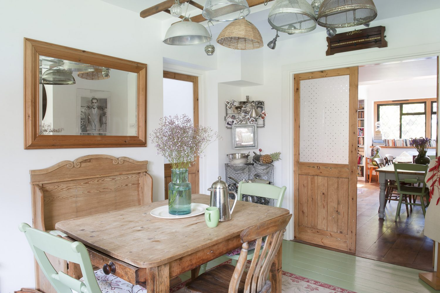 Etched glass doors lead off from the kitchen into the dining room and utility room