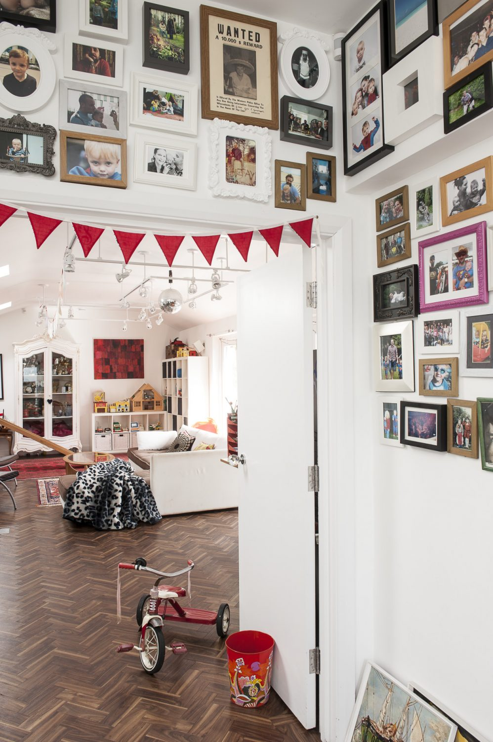Hordes of photographs mounted along the walls that lead to the family den chart the family's lives