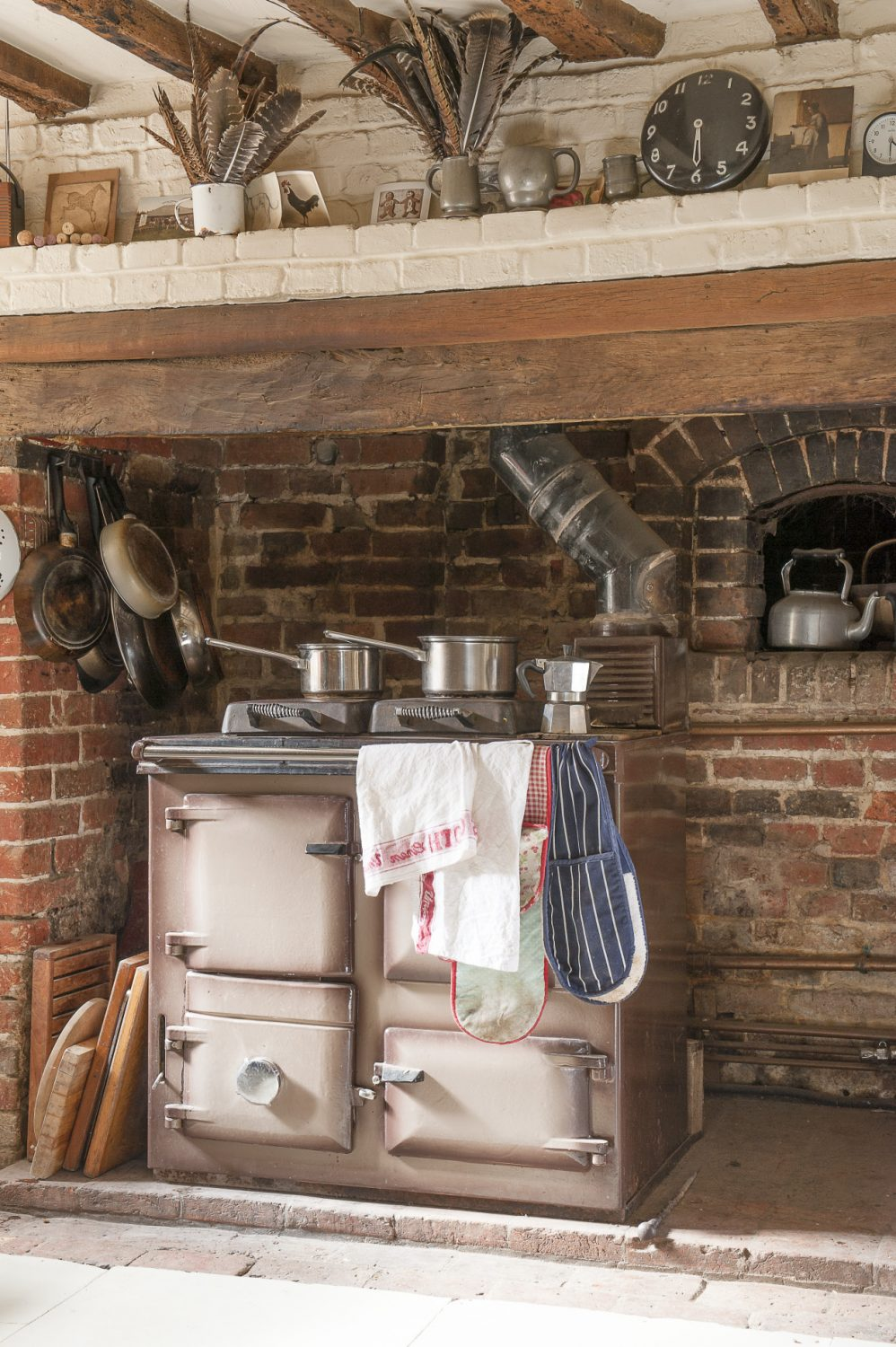 One of the only fixed pieces in the kitchen is the 1970s Rayburn that nestles in the sizeable inglenook