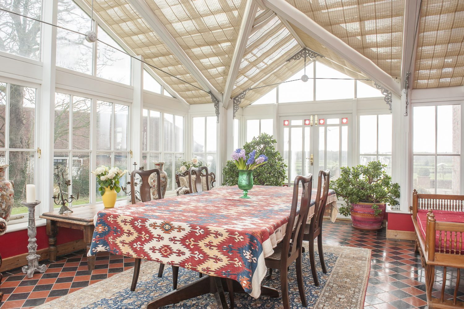 The large conservatory looks out over one of the couple's two beautiful large ponds. Centrepiece of the room is a great table that previously belonged to the Bank of Siena
