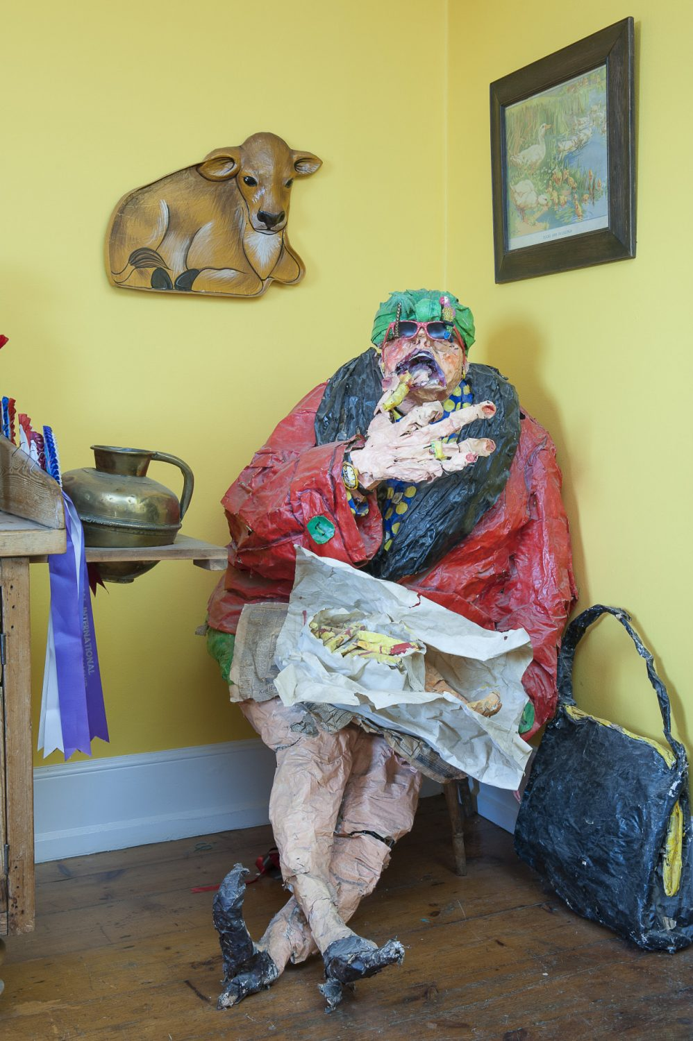 In one corner of the kitchen sits a vast papier mâché old lady eating fish and chips by Hastings artist Jo Redpath