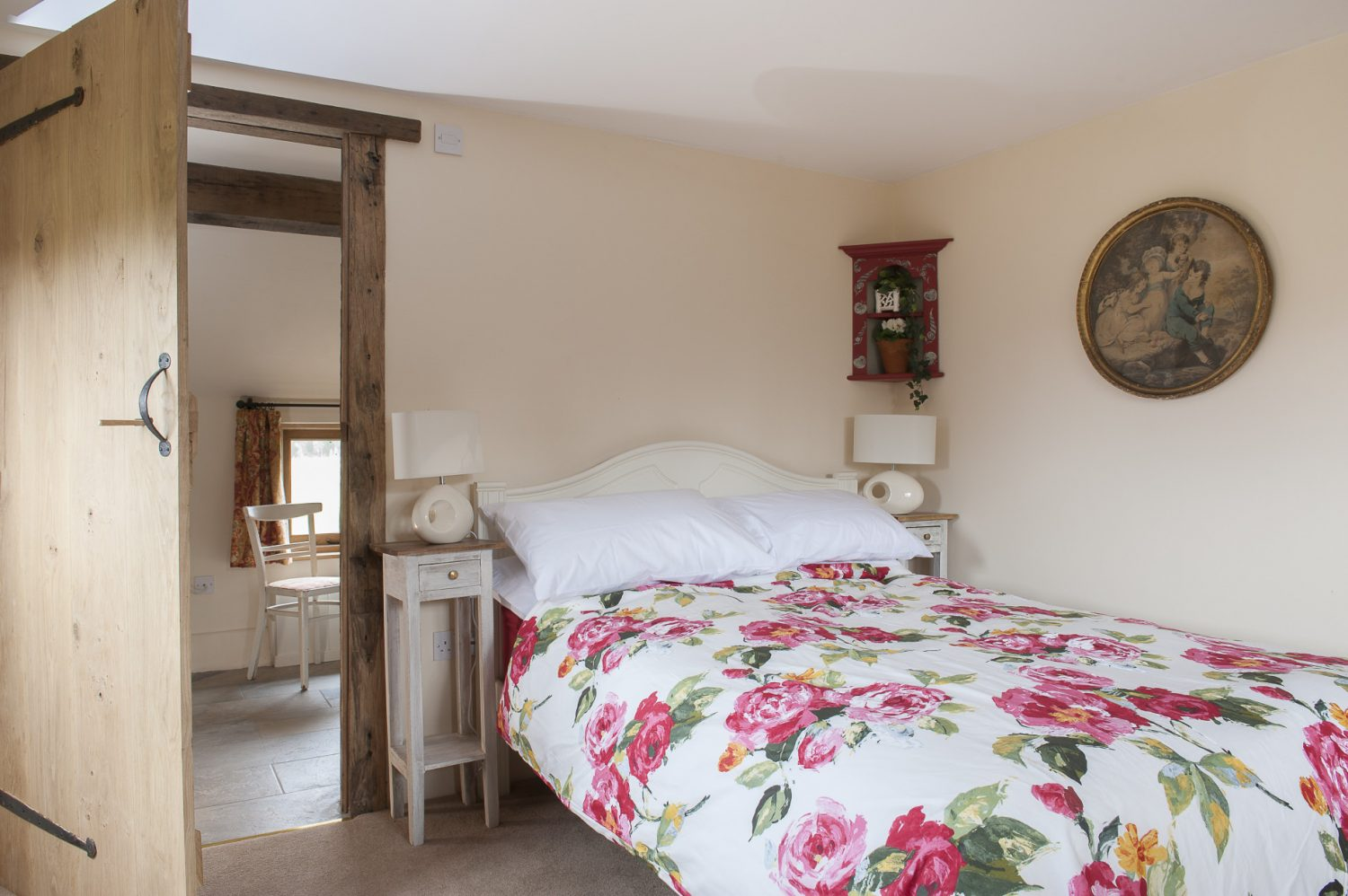Downstairs in the main bedroom, two dining chairs have been painted white and recovered in Beaumont & Fletcher. Caroline found the corbel on one wall at Symonds Salvage in Pluckley and the distressed leather-topped writing desk at Rising Star in Tenterden