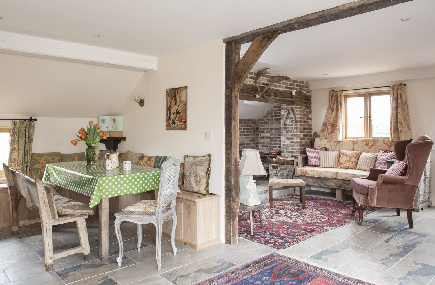 The sitting room sofa is made from driftwood from Hastings and was crafted by Caroline's favourite joiner Colin Smith and cushioned in floral fabric from Beaumont & Fletcher