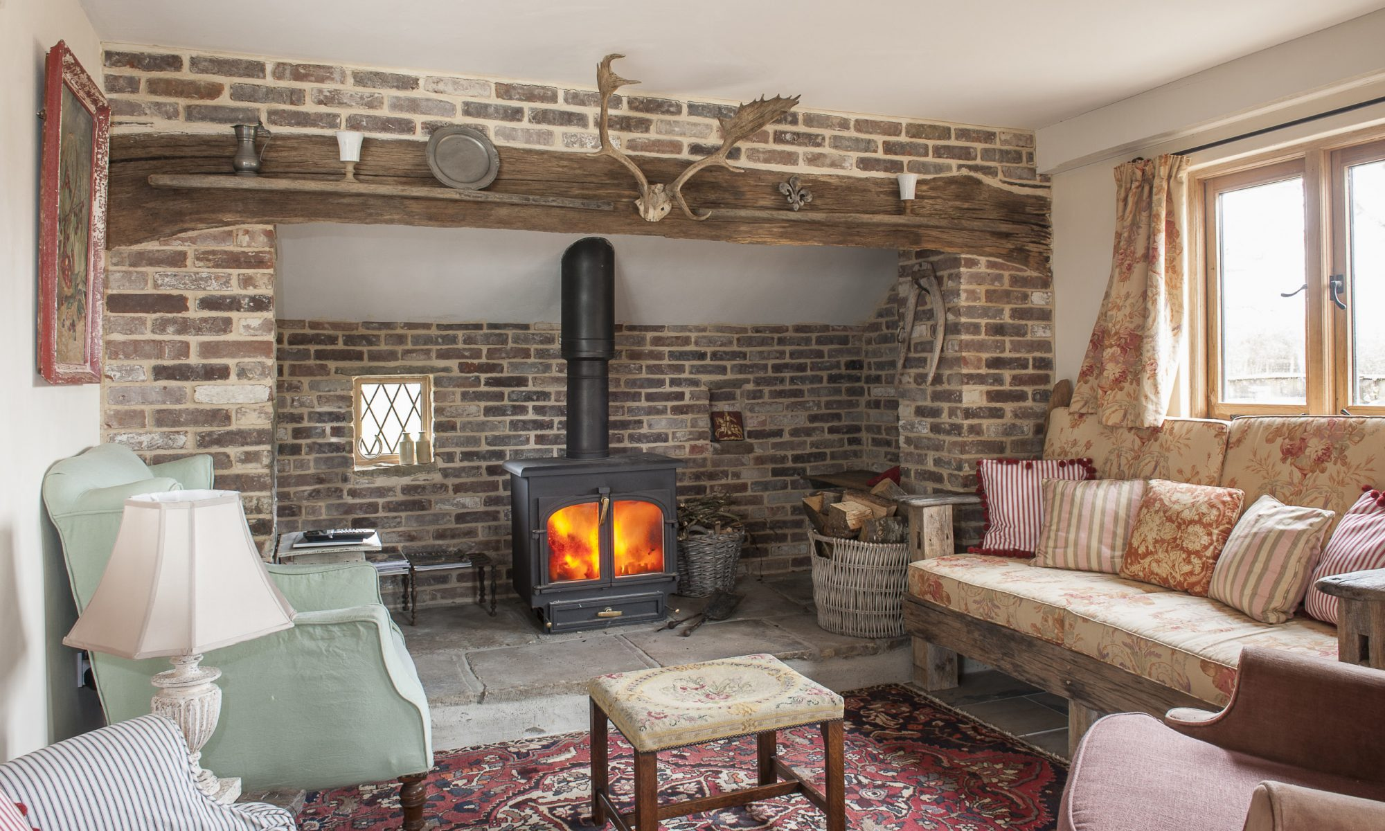 In order not to waste space under the sloping ceilings at the end of the garage, Caroline incorporated a sizeable inglenook that runs the full width of the room
