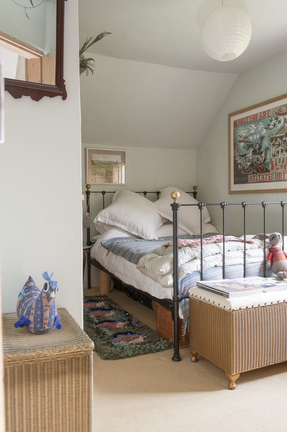 The bed in the guest room is dressed with an invitingly cosy eiderdown and plump pillows
