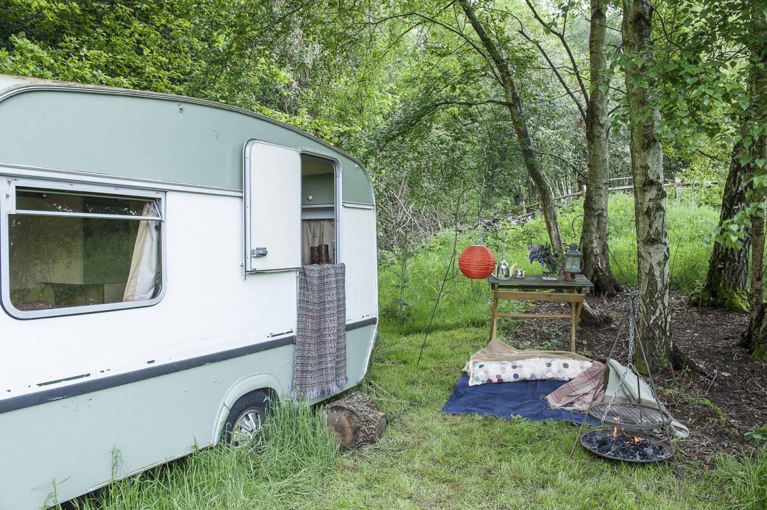At the bottom of the paddock an old caravan is another of Wendy's projects in progress. Cranbrook Iron's mini firebowl with a tripod grill is the perfect way to enjoy summer evenings in the garden