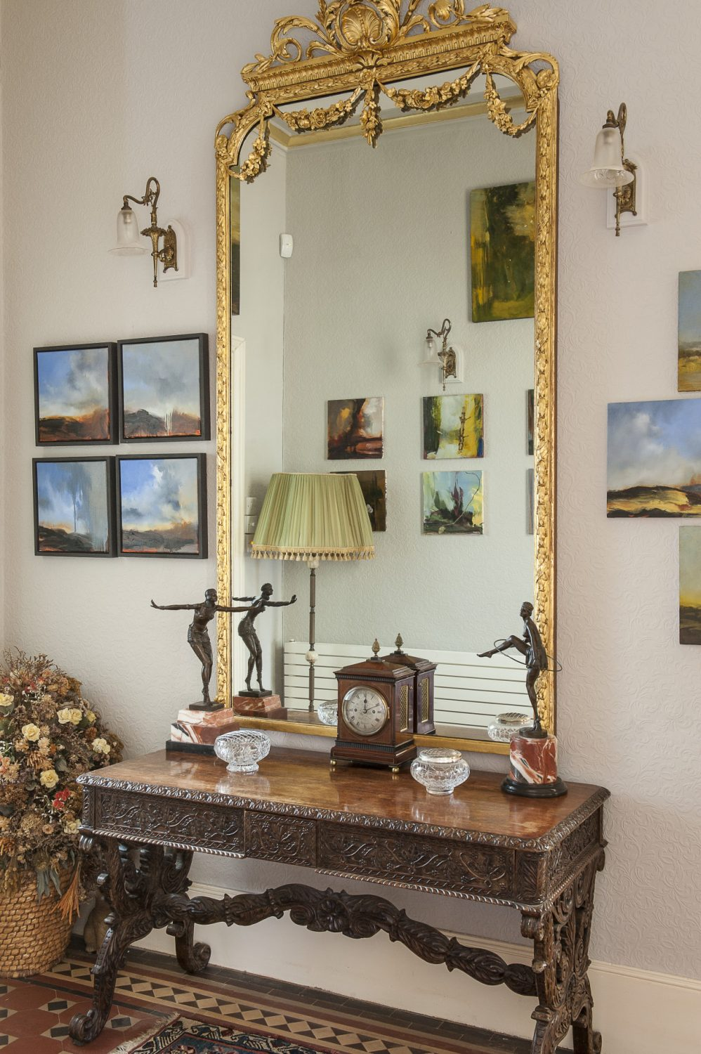The large gilt mirror in the hallway reflects part of Ken's collection of Rankle