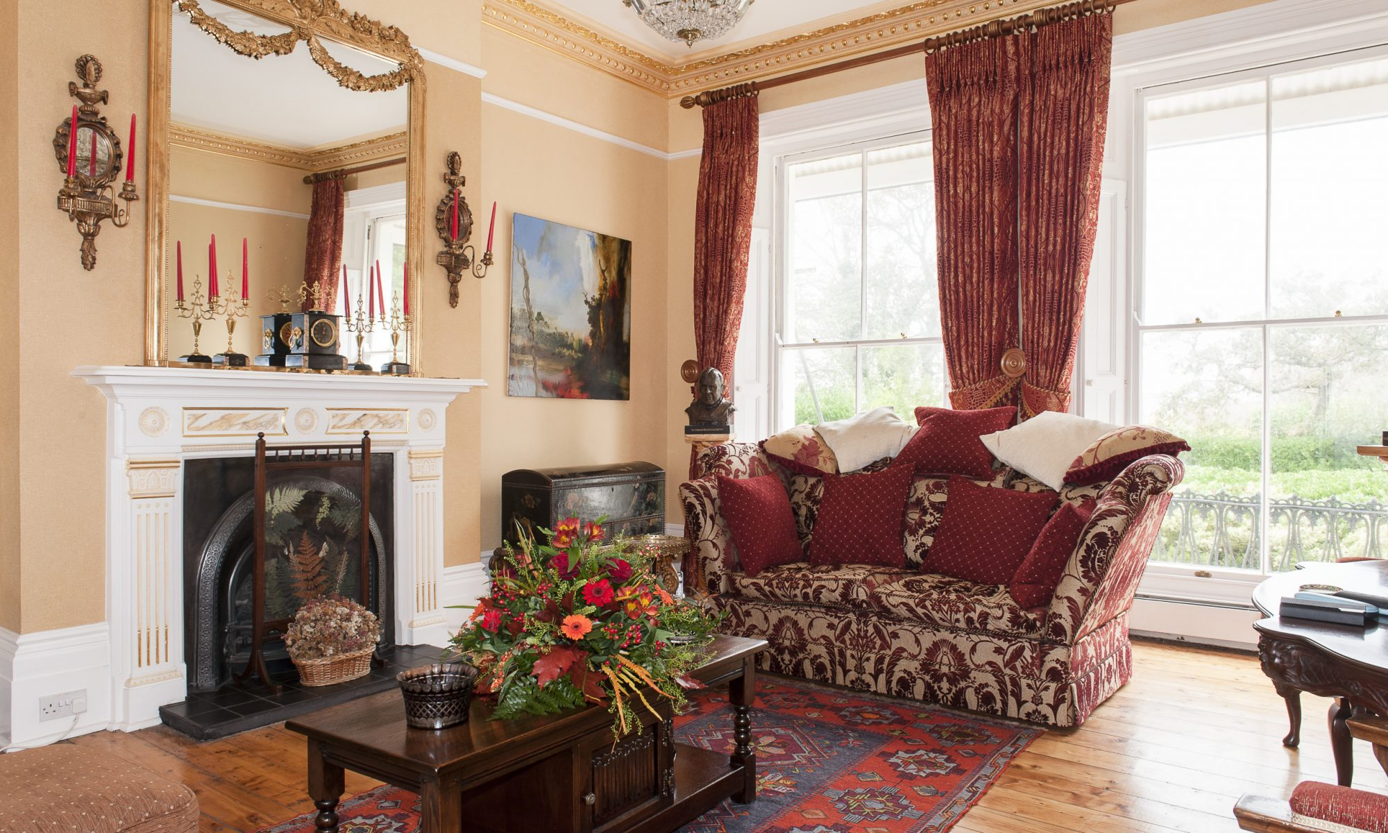 In the drawing room, above the grand white faux marble fireplace finished by Hastings specialist painter Alan Kent, is a massive gilt mirror in which is reflected the room's pièce de résistance